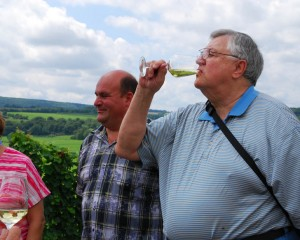 Trip 246: Carl tiedt has been researching his family tree for decades. On August 7, he toasted his ancestors in a vineyard once owned by them before their emigration in the 1880s. Prior planning and research by our German partner led to this unforgettable moment. Carl's cousin made the wine he is drinking above Veldenz, Mosel Valley.