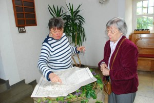 Margie Weiler and Frau Lauk, left, going over the old plan of the town