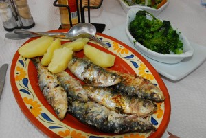 Grilled sardines seaside at the end of the road, 1,855 kilometers after leaving Stuttgart