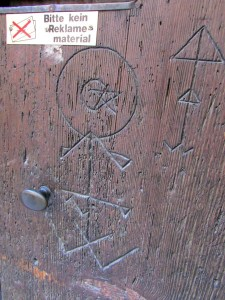 A door with marks from pilgrims, notes to others left behind more than four centuries ago