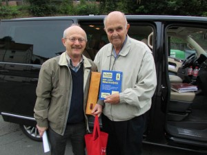 Reinhard Bauerfeind, left, and Ken Temple. Ken had just been presented with a complimentary copy of the town history, co-authored by Bauerfeind.