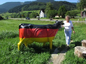Gloria Temple with a German dairy cow during her ancestral trip along with her husband Ken, September, 2013 in the Black Forest of Germany.