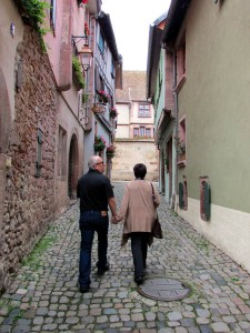 Jim and Denise walk down a quiet lane in Riquewihr