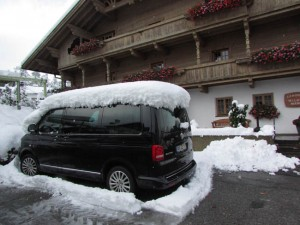 Surprise! We woke to more than ten inches of fresh snow on top of everything, including our touring van