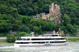 The ship 'Vater Rhein' cruises past a 12th century castle near Assmannshausen
