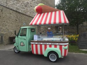 This customized Piaggio from Italy attracts passing traffic outside the town gate of Hainburg, Austria